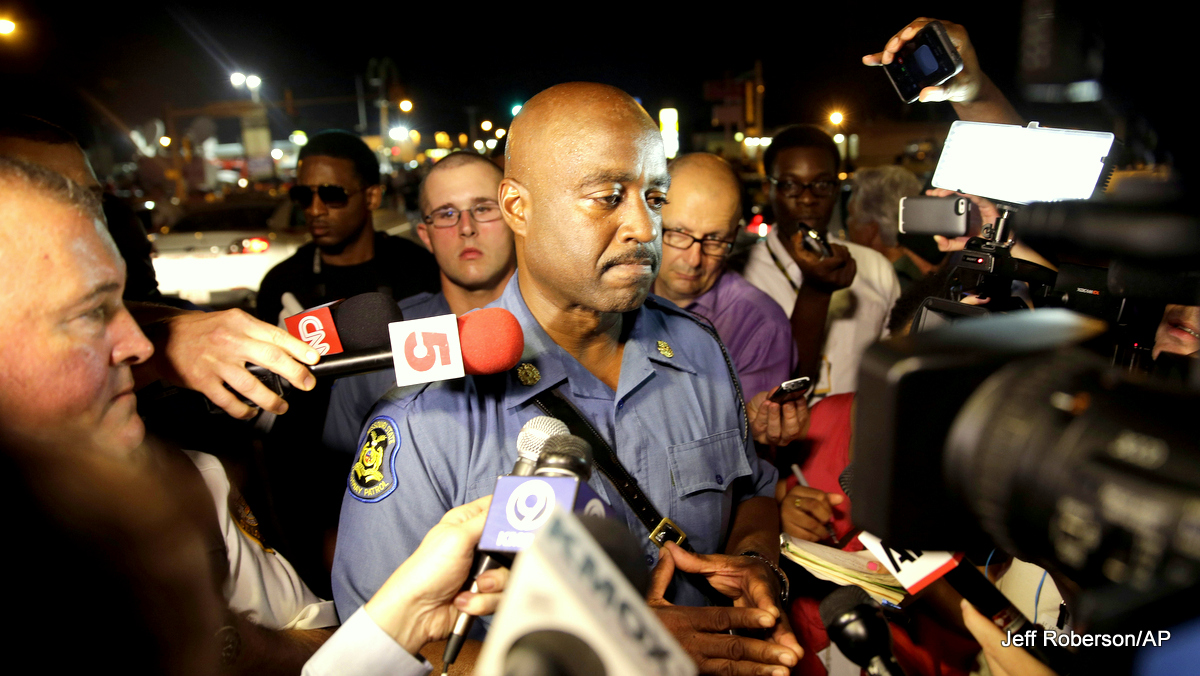 Capt. Ron Johnson of the Missouri Highway Patrol is surrounded by media after meeting with protesters Monday, Aug. 18, 2014, in Ferguson, Mo. The Aug. 9 shooting of Michael Brown by a police officer has touched off rancorous protests in Ferguson, a St. Louis suburb where police have used riot gear and tear gas.