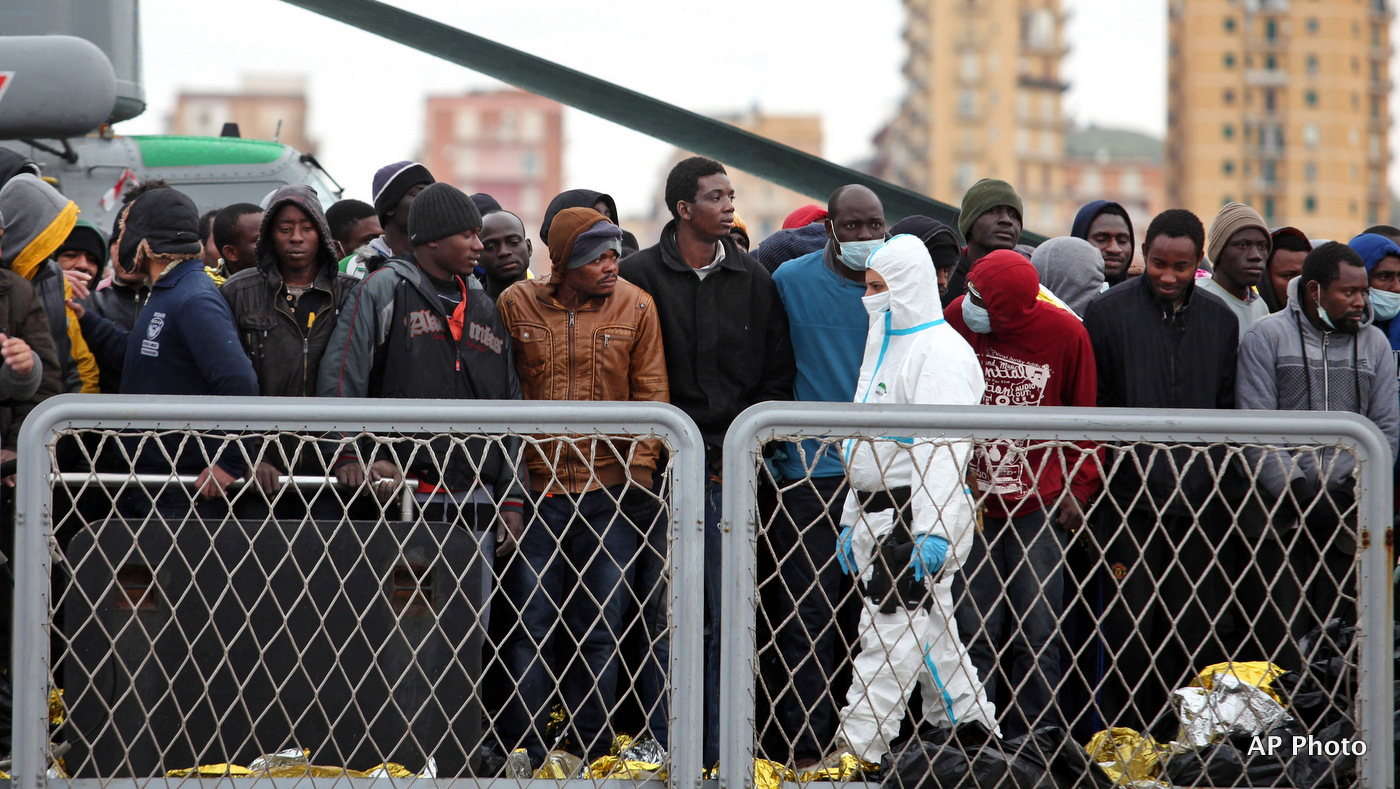 Migrants wait to disembark from a tug boat after being rescued in Porto Empedocle, Sicily, southern Italy, Tuesday, Feb. 17, 2015. (AP Photo/Francesco Malavolta)