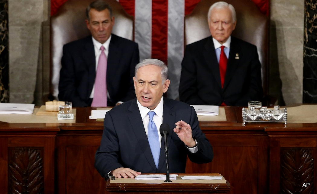 Israeli Prime Minister Benjamin Netanyahu speaks before a joint meeting of Congress on Capitol Hill in Washington, Tuesday, March 3, 2015. Netanyahu said the world must unite to `stop Iran's march of conquest, subjugation and terror'. House Speaker John Boehner of Ohio, left, and Sen. Orrin Hatch, R-Utah listen.
