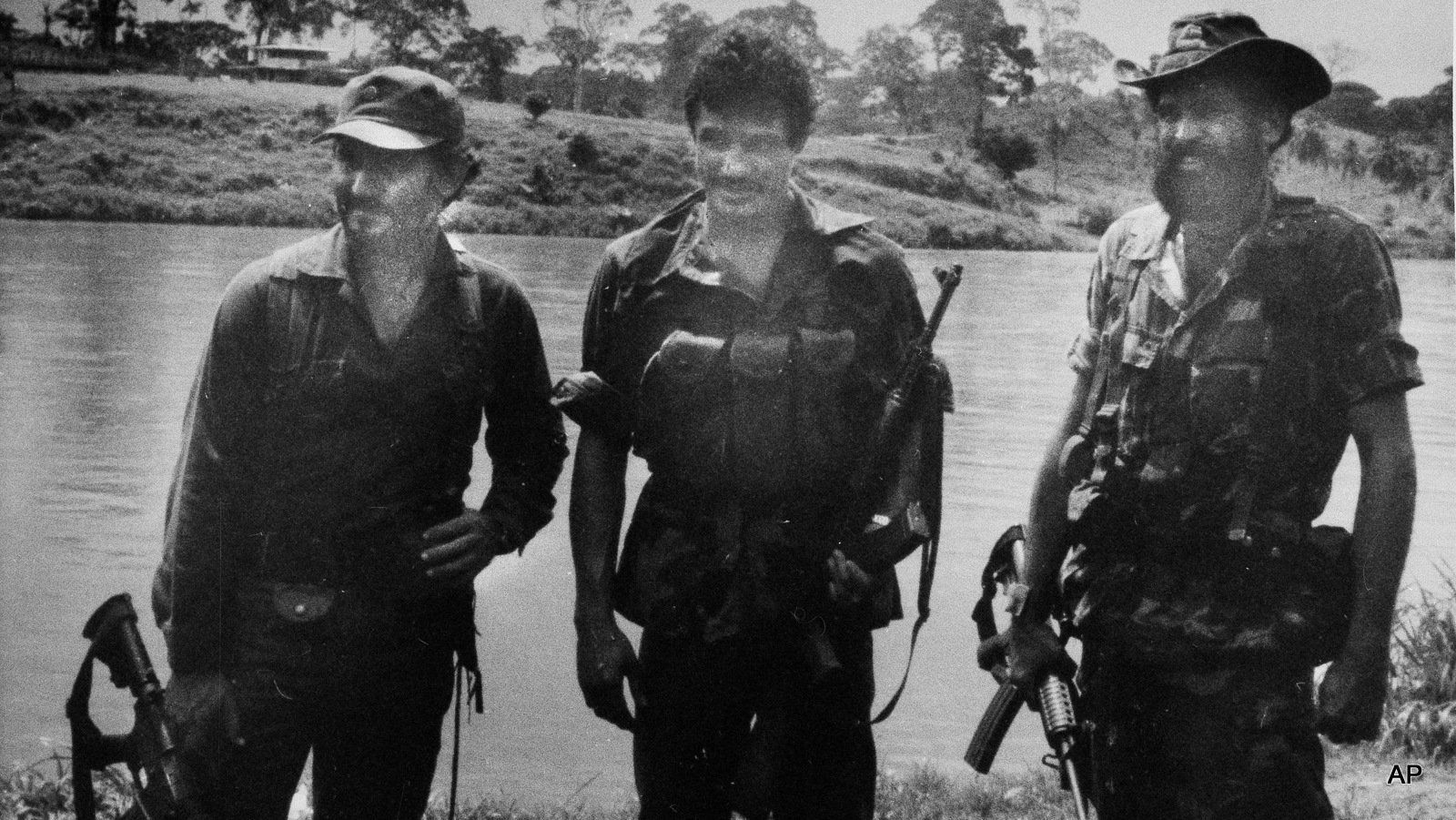 U.S. backed Nicaraguan rebel leader stands with guerrilla fighters with  in their camp in southern Nicaragua, 1983.  The rebel, trained, armed and funded by the CIA, formerd to overthrow the Nicaraguan Sandinista government.