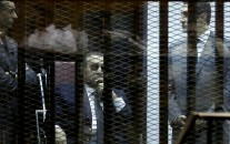 "Former Egyptian President Hosni Mubarak, seated, and his two sons Gamal Mubarak, left, and Alaa Mubarak, right, attend the verdict of the corruption case dubbed by the Egyptian media as the ""presidential palaces"" affair concerning charges that Mubarak and his two sons embezzled millions of dollars' worth of state funds over the course of a decade in a courtroom in Cairo, Egypt, Saturday, May 9, 2015. Egypt's deposed leader Hosni Mubarak and his two sons were sentenced Saturday to three years in prison and a fine in a retrial on corruption charges they faced earlier. It wasn't immediately clear whether it will include time he's already served since his country's 2011 revolt."