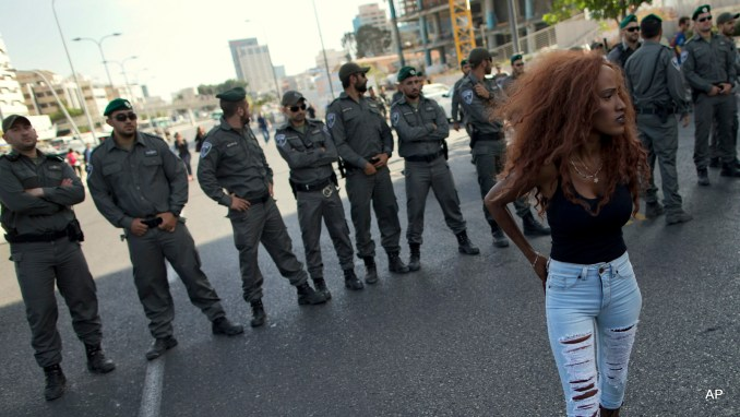 Israel's Jewish Ethiopians block highway during a protest against racism and police brutality in Tel Aviv, Israel, Sunday, May 3, 2015. Several thousand people, mostly from Israel's Jewish Ethiopian minority, protested in Tel Aviv against racism and police brutality on Sunday shutting down a major highway and scuffling with police.