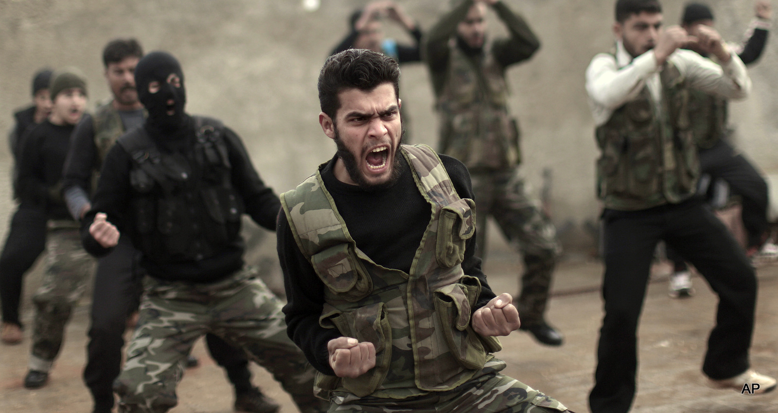 Syrian rebels attend a training session in Maaret Ikhwan near Idlib, Syria.