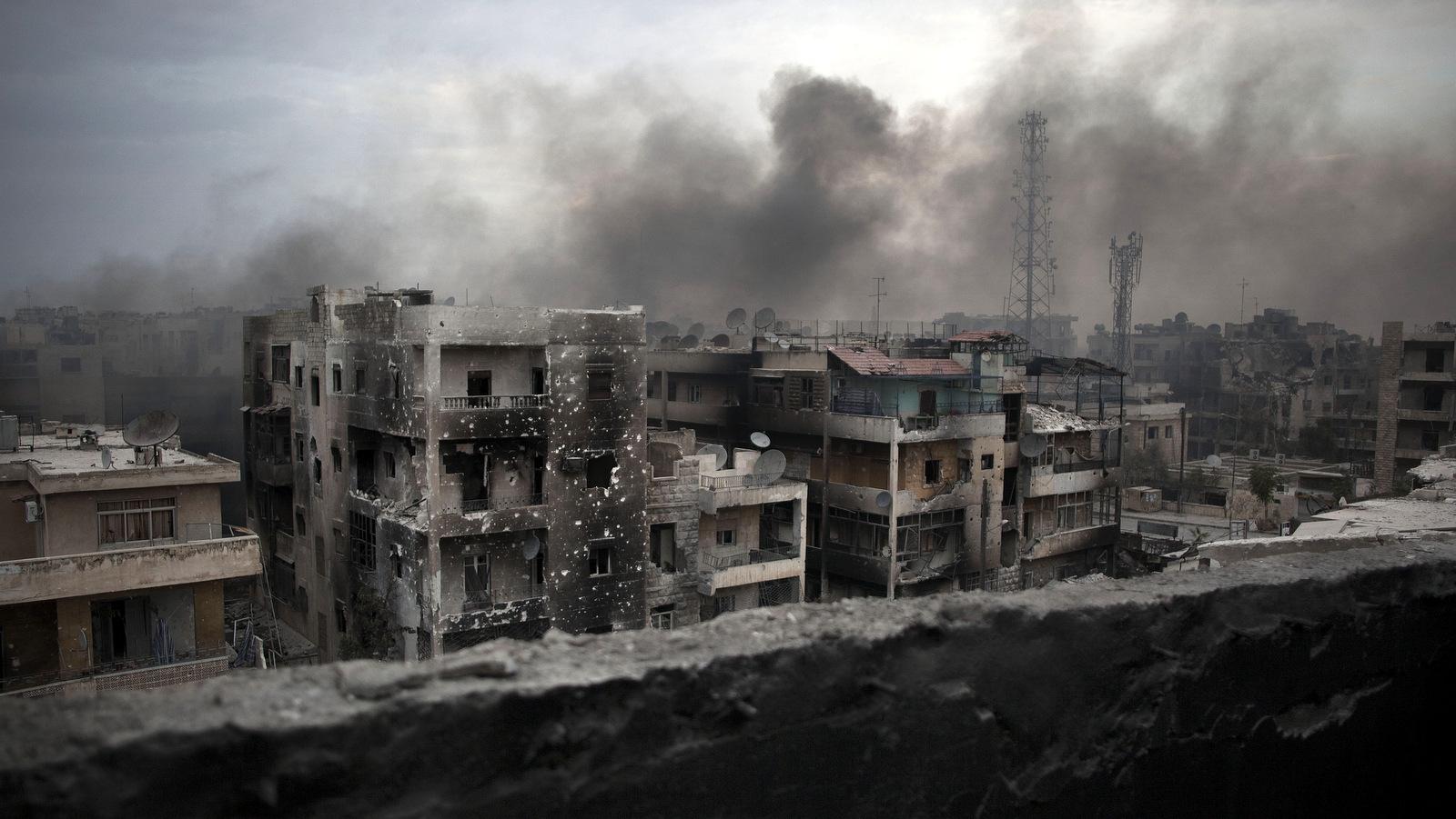 Smoke rises over Saif Al Dawla district in Aleppo, Syria, Tuesday, Oct. 2, 2012 .(AP Photo/ Manu Brabo)