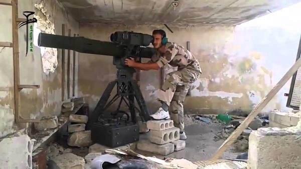 A Syrian rebel firing a TOW missle.