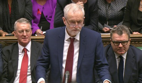 Opposition Labour Party leader, Jeremy Corbyn, centre, stands as he makes a speech to lawmakers inside the House of Commons in London, during a debate on launching airstrikes against ISIS extremists inside Syria, Wednesday, Dec. 2, 2015. Shadow Foreign Secretary Hilary Ben sitting left, and Labour Party Deputy leader Tom Watson, right. The parliamentary vote is expected Wednesday evening. (Parliamentary Recording Unit via AP Video)