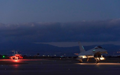 British Typhoon warplanes are seen on the ground after landing at the RAF Akrotiri, a British air base near the coastal city of Limassol, Cyprus, Thursday, Dec. 3, 2015. British warplanes carried out airstrikes in Syria early Thursday, hours after Parliament voted to authorize the attacks. (AP Photo/Pavlos Vrionides)