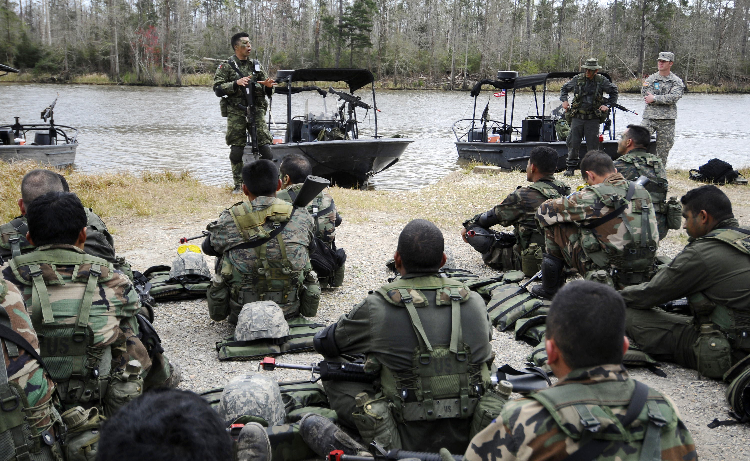 A guest instructor debriefs students from the Western Hemisphere Institute for Security Cooperation and Naval Small Craft Instruction and Technical Training School after a field training exercise. (U.S. Navy photo)