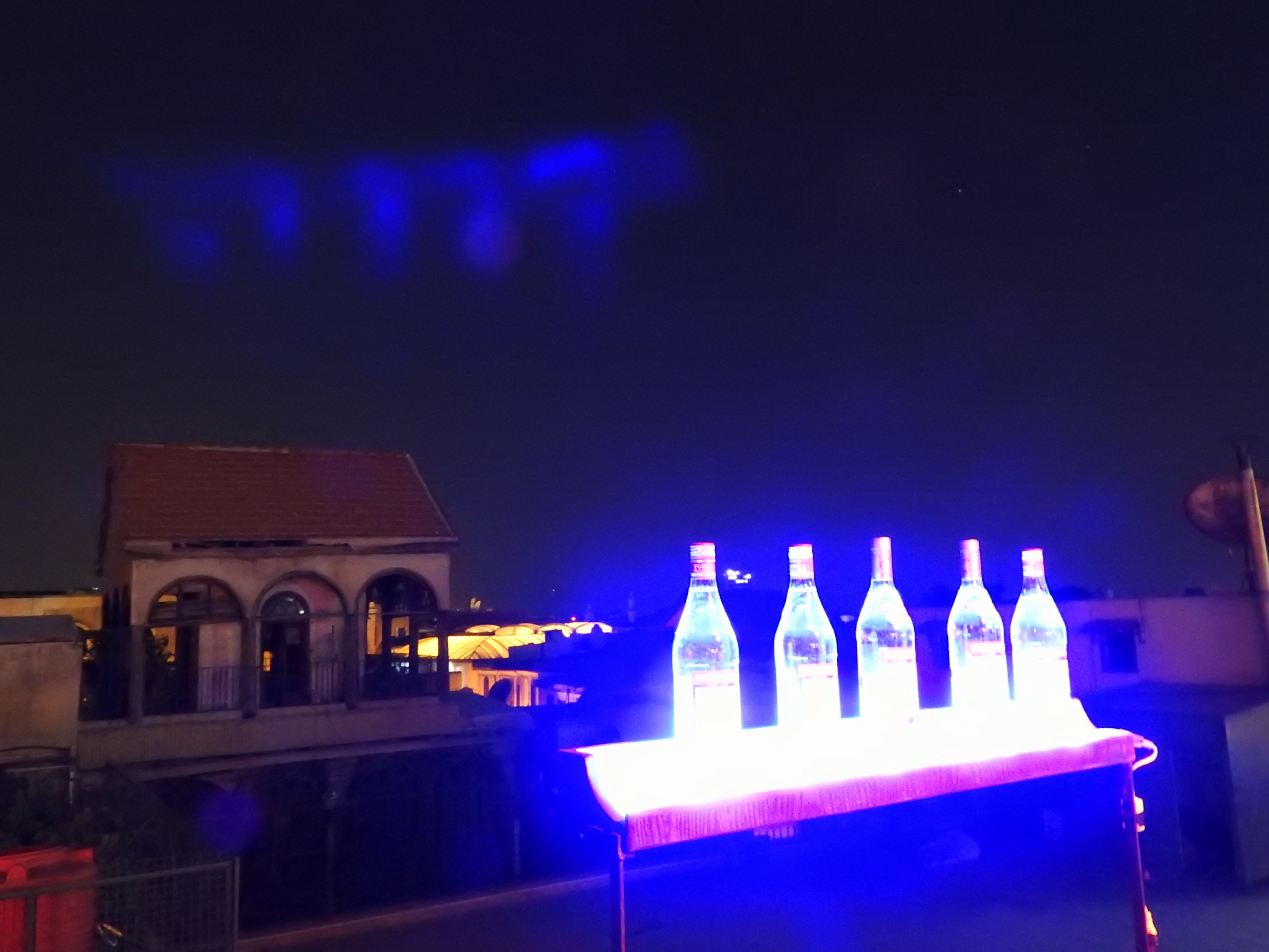 "Le Visage, also in the East Gate quarter, was among the first outdoor establishment to open after the mortars stopped some months ago. From its rooftop position, one can look down on the historic Straight Street leading up to East Gate, as well as see life on balconies opposite, where months prior they were empty. A display of lighted alcohol bottles gleam in the dark, with Jobar less than 1 km beyond. A Damascus youth noted: ""Imagine, ISIS are about 4 km away and we are opening new bars. This is the Syrian people."""
