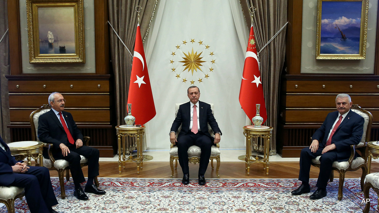 Turkey's President Recep Tayyip Erdogan, centre, Republican People's Party leader Kemal Kilicdaroglu, second left, National Movement Party leader Devlet Bahceli, left and Prime Minister Binali Yildirim look on at the start of their meeting in Ankara, Turkey, Monday, July 25, 2016.