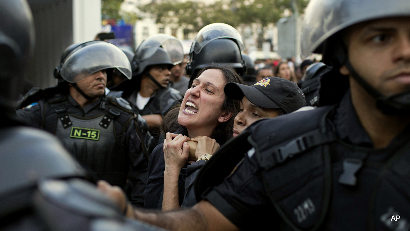 A demonstrator is taken away by riot police during a protest against the money spent on the Rio's 2016 Summer Olympics on the route of the olympic torch in Niteroi, Brazil, Tuesday, Aug. 2, 2016. The three-month torch relay across Brazil will end at the opening ceremony on Aug. 5, in Rio de Janeiro's Maracana stadium.