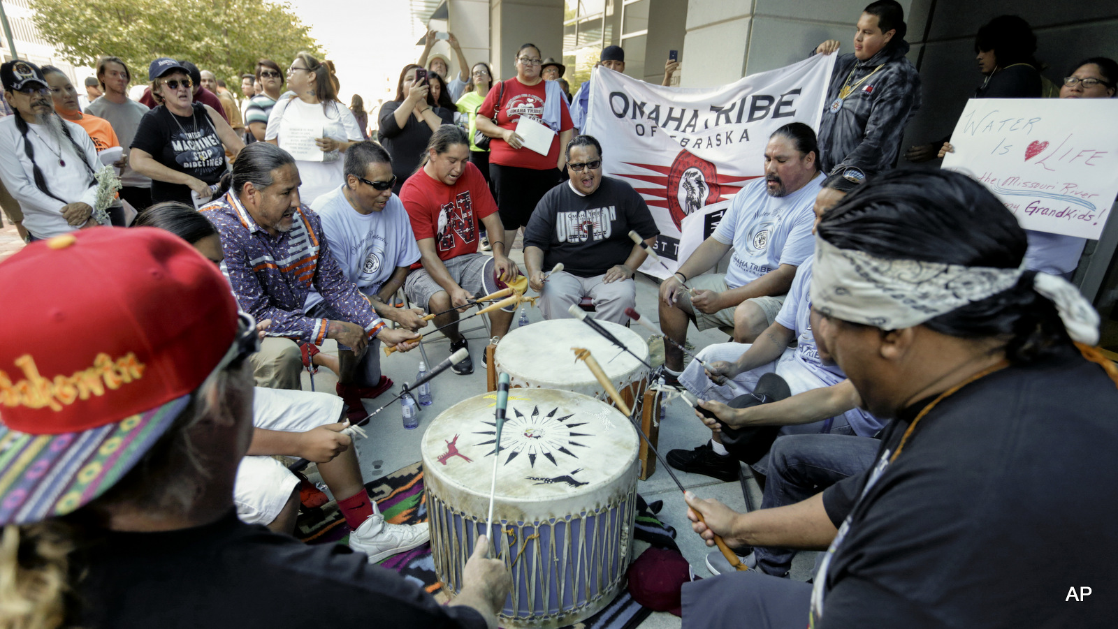 Members of the Ponca, Santee, Winnebago and Omaha Tribes in Nebraska and Iowa along with others participate gather during a rally on Thursday, Sept. 8, 2016, in front of the Army Corps of Engineers offices in Omaha, Neb., to protest against the Dakota Access Pipeline in the Dakotas and Iowa.