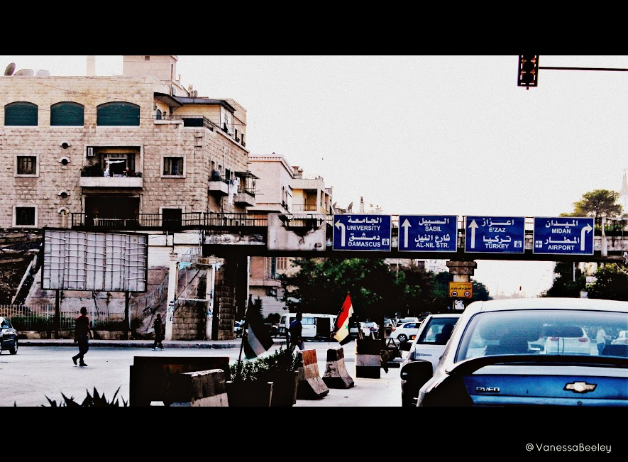 Driving through western Aleppo at dusk. (Photo by Vanessa Beeley)