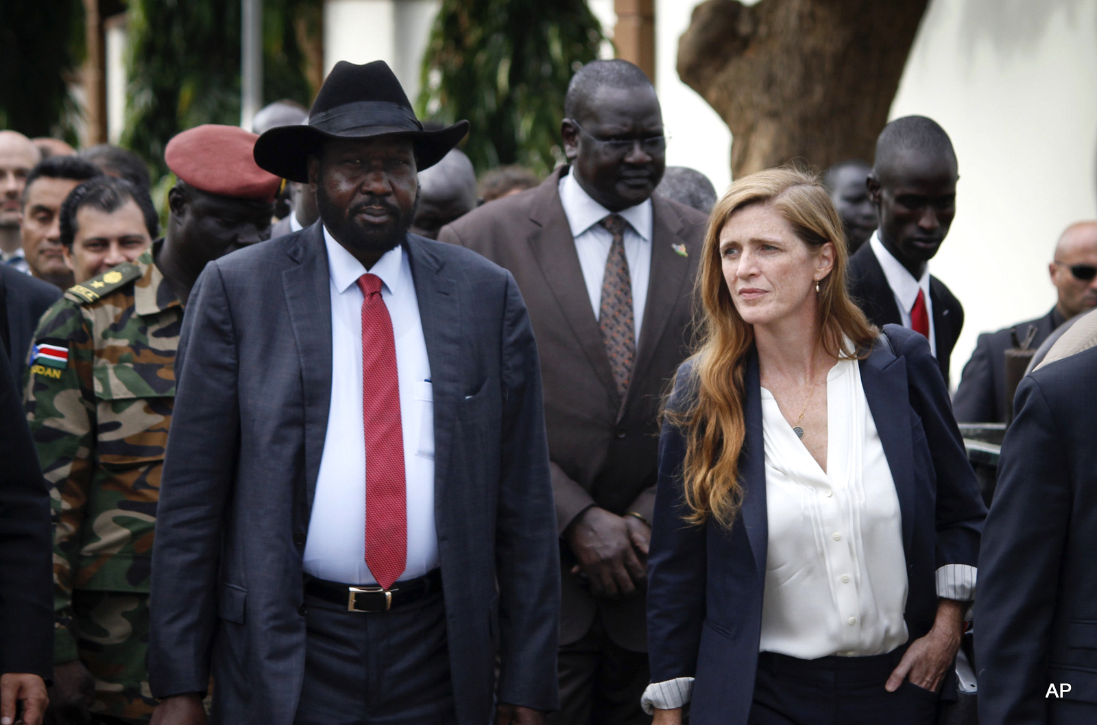 South Sudan's President Salva Kiir, left, walks with U.S. Ambassador to the United Nations Samantha Power, right, and other visiting members of the UN Security Council in the capital Juba, South Sudan, Sunday, Sept. 4, 2016. South Sudan has agreed to the deployment of a 4,000-strong regional protection force approved by the U.N. Security Council after first rejecting the peacekeepers as a violation of its sovereignty.