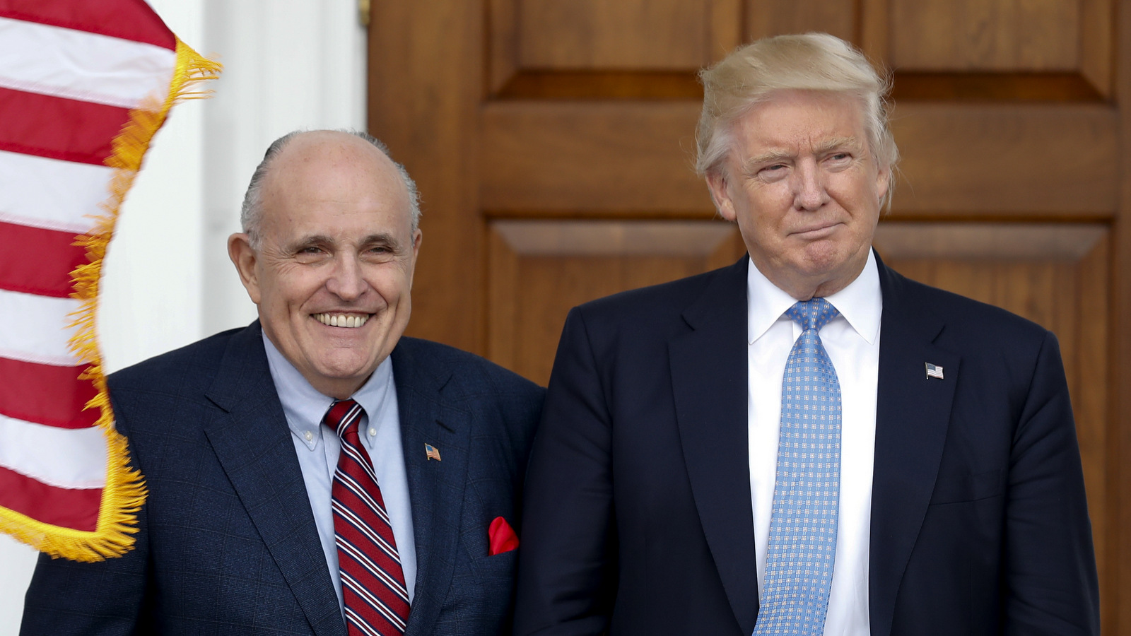President-elect Donald Trump, right, and former New York Mayor Rudy Giuliani pose for photographs as Giuliani arrives at the Trump National Golf Club Bedminster clubhouse, Sunday, Nov. 20, 2016, in Bedminster, N.J.. (AP Photo/Carolyn Kaster)