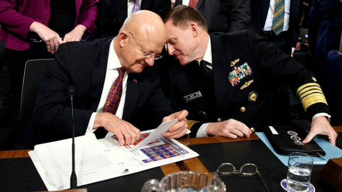 "Director of National Intelligence James Clapper, left, talks with National Security Agency and Cyber Command chief Adm. Michael Rogers on Capitol Hill in Washington, Thursday, Jan. 5, 2017, at the conclusion of a Senate Armed Services Committee hearing: ""Foreign Cyber Threats to the United States."" (AP/Evan Vucci)"