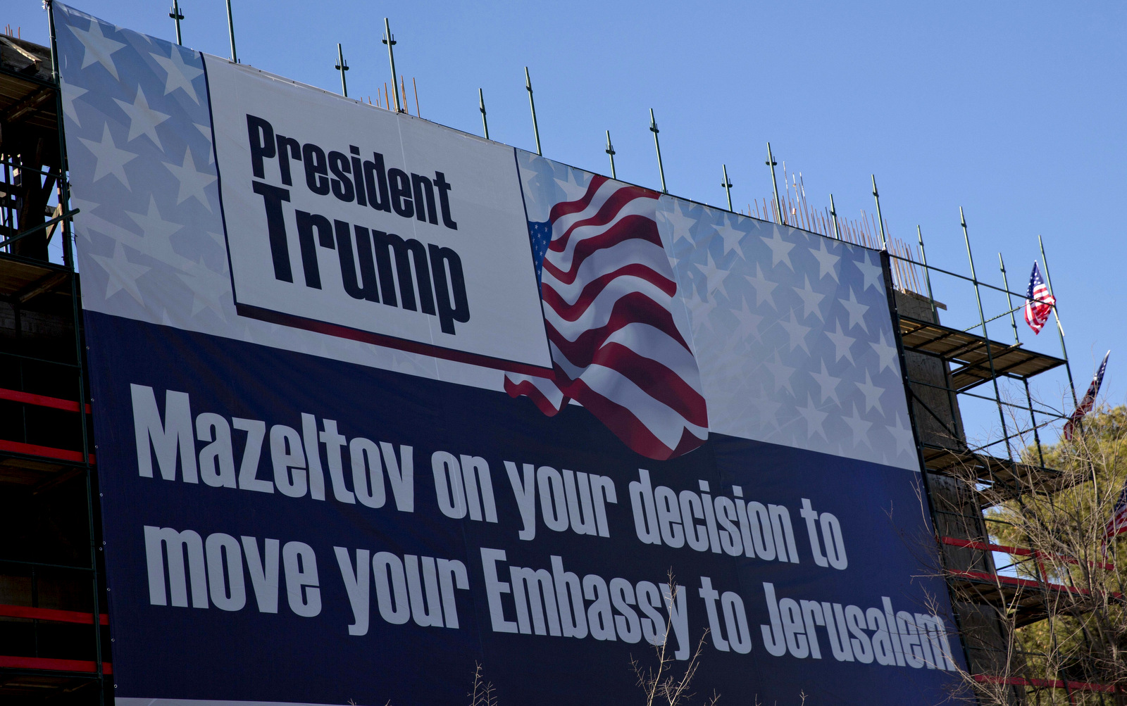 A sign hangs on a building under construction in Jerusalem congratulating U.S. President Donald Trump, Friday, Jan. 20, 2017. Trump has vowed to move the U.S. embassy from Tel Aviv to Jerusalem. (AP/Ariel Schalit)