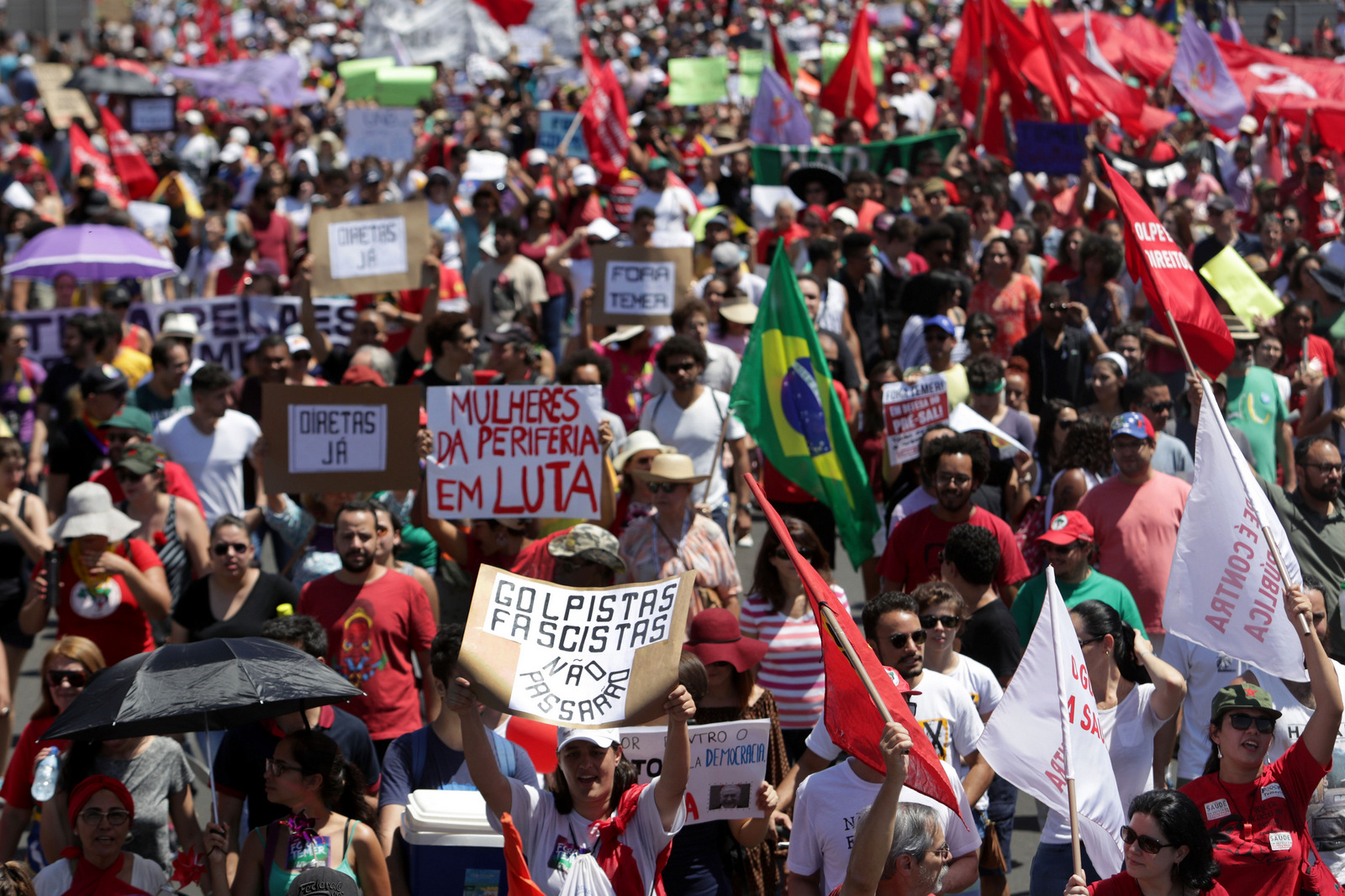 Demonstrators protest Brazil's President Michel Temer after a military Independence Day parade in Brasilia, Brazil, Wednesday, Sept. 7, 2016. (AP/Eraldo Peres)