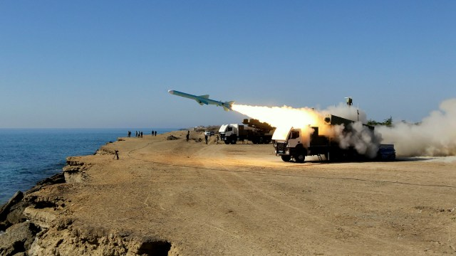 A Ghader test missile is launched from the area near the Iranian port of Jask port on the shore of the Oman Sea during an Iranian navy drill, Tuesday, Jan. 1, 2013.