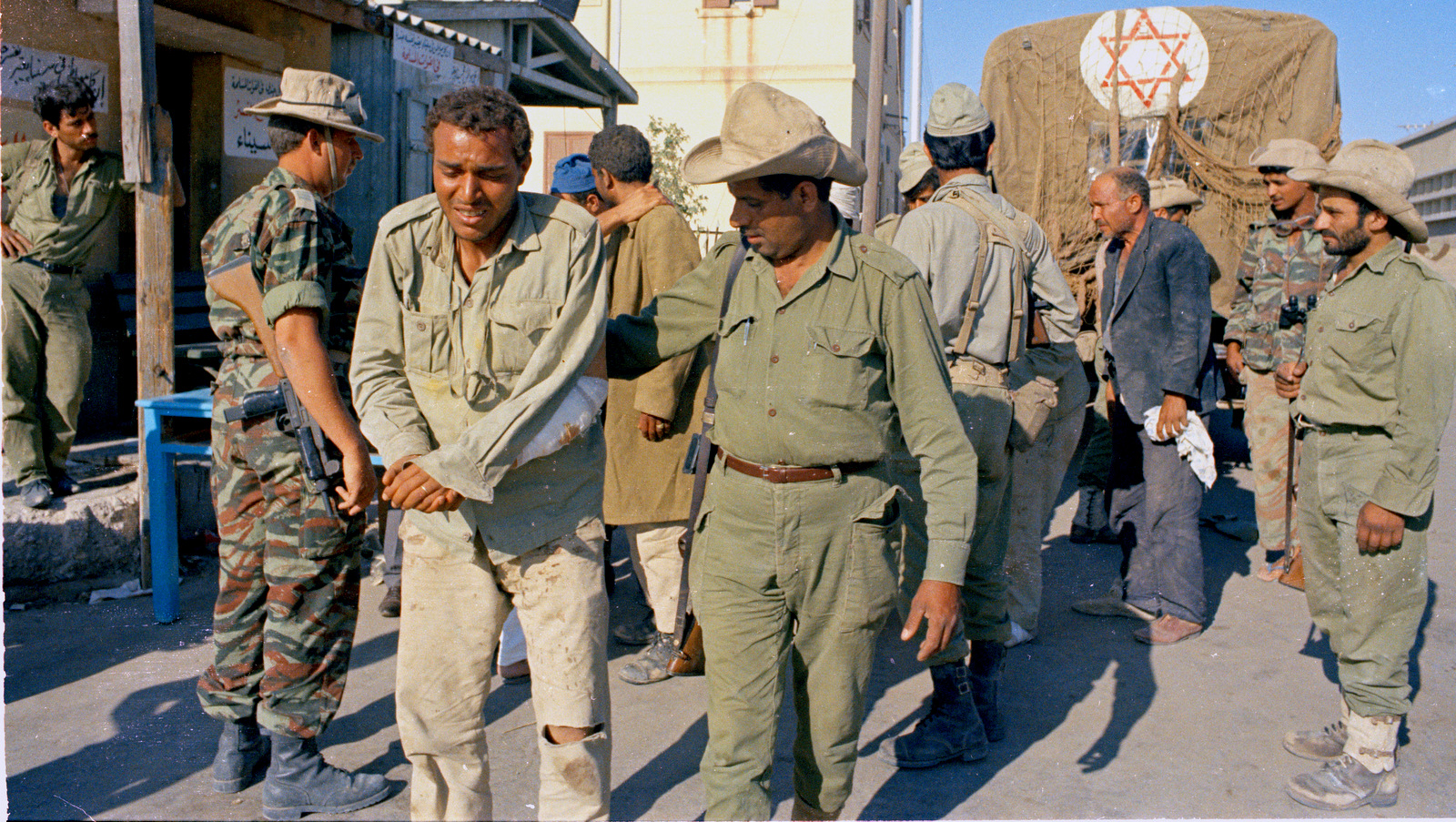 An Israeli soldier is seen with an Arab prisoner, June 1967. (AP Photo)