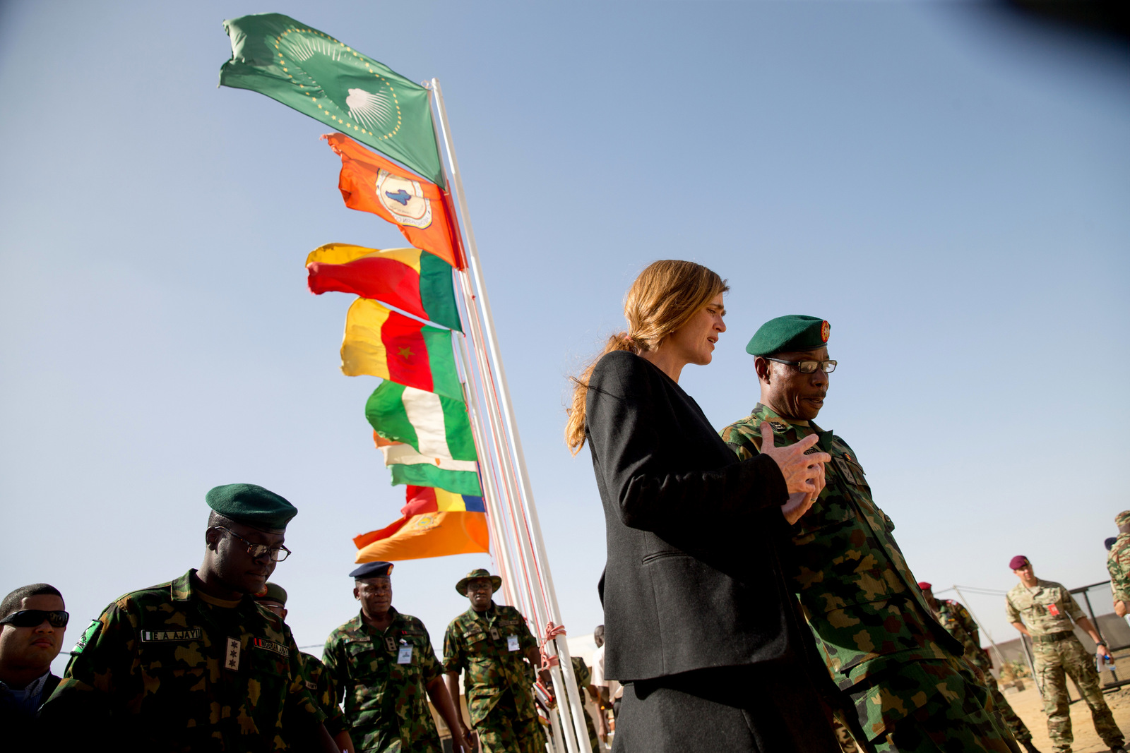 Former U.S. Ambassador to the United Nations Samantha Power speaks with Multinational Joint Task Force Commander Maj. Gen. Lamidi Adeosun, right, as she departs their headquarters in N'Djamena, Chad,, April 20, 2016. (AP/Andrew Harnik)