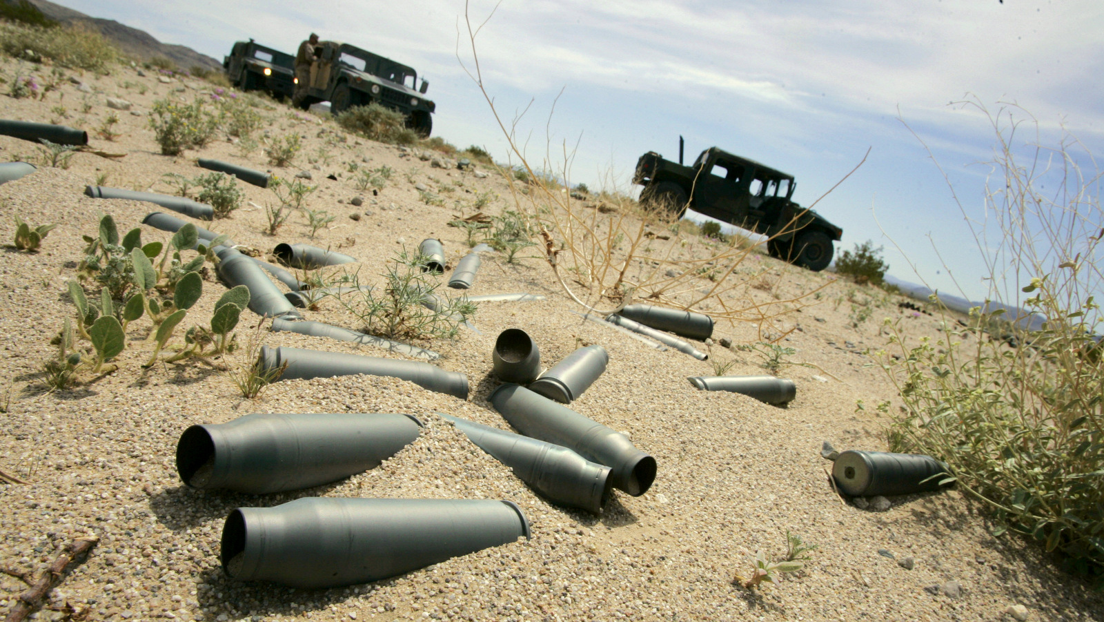 Spent shell casings from firing practice litter the desert of the U.S. Marine Corps' Air Ground Combat Center at Twentynine Palms, California. (AP/Reed Saxon)