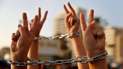 Palestinian boys raise up their hands with chains, during a protest to show their solidarity with hunger striking Palestinian prisoners in Israeli jails, who have been on an open-ended hunger strike for the past 18 days, in Beirut, Lebanon, Thursday, May 4, 2017. (AP/Hussein Malla)