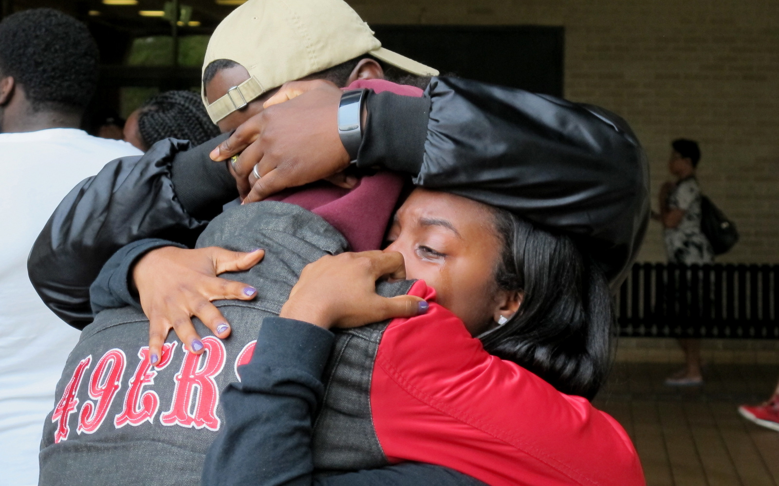 Mourners embrace at a vigil for Richard Collins III, who was stabbed to death in College Park, Maryland. (AP/Brian Witte)