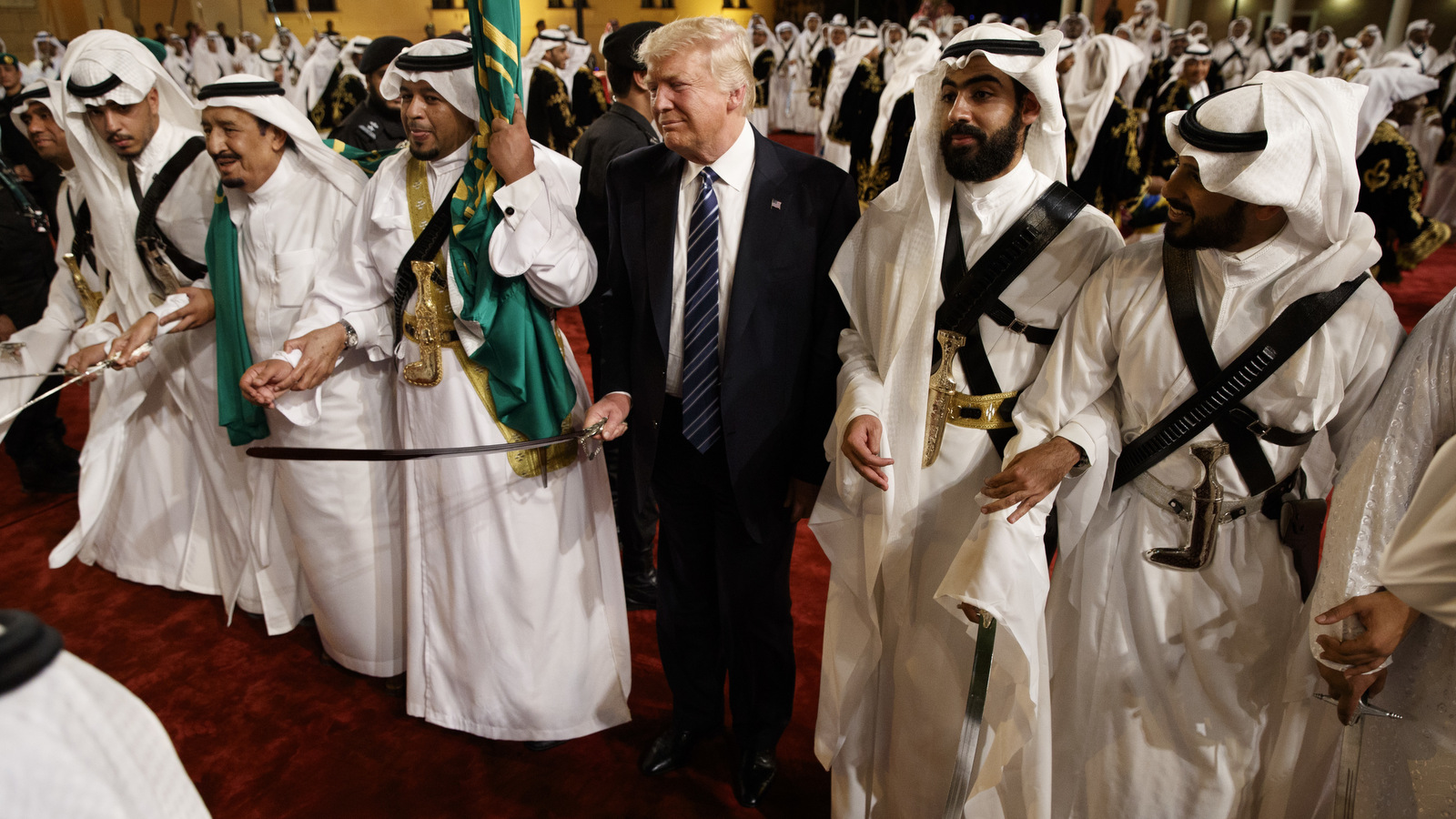 Donald Trump holds a sword and sways with traditional dancers during a welcome ceremony at Murabba Palace, in Riyadh, May 20, 2017. (AP/Evan Vucci)