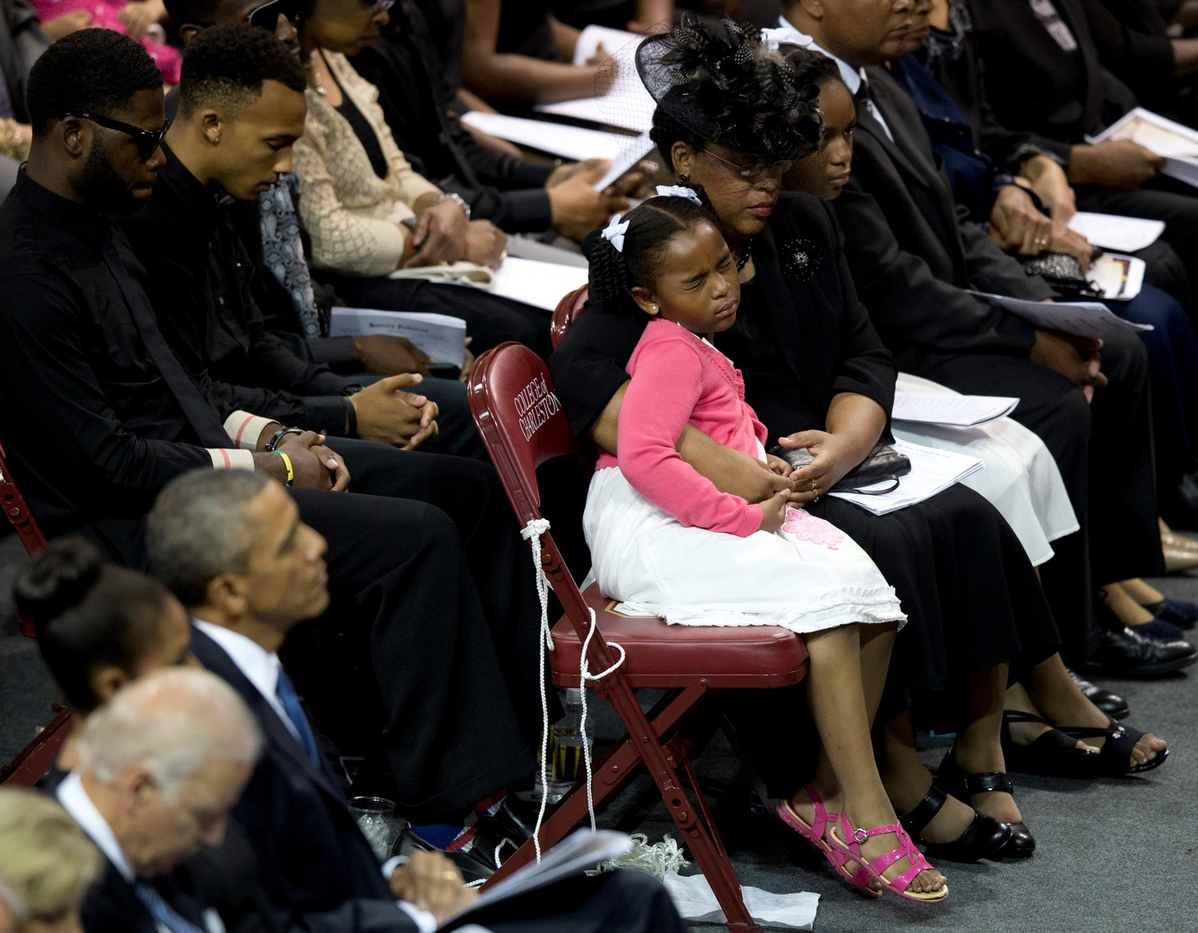 The widow of Clementa Pinckney, a pastor and South Carolina lawmaker slain in the mass murder at Charleston's Mother Emanuel African Methodist Episcopal Church, hugs her daughter during a 2015 memorial service for victims of that attack. (AP/Carolyn Kaster)