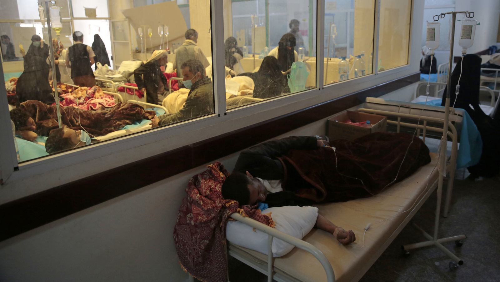 People are treated for suspected cholera infection at a hospital in Sanaa, Yemen, May. 15, 2017. While cholera is easily treated, the Saudis' ongoing blockade has crippled Yemen's health system, making it unable to respond to the crisis.(AP/Hani Mohammed)
