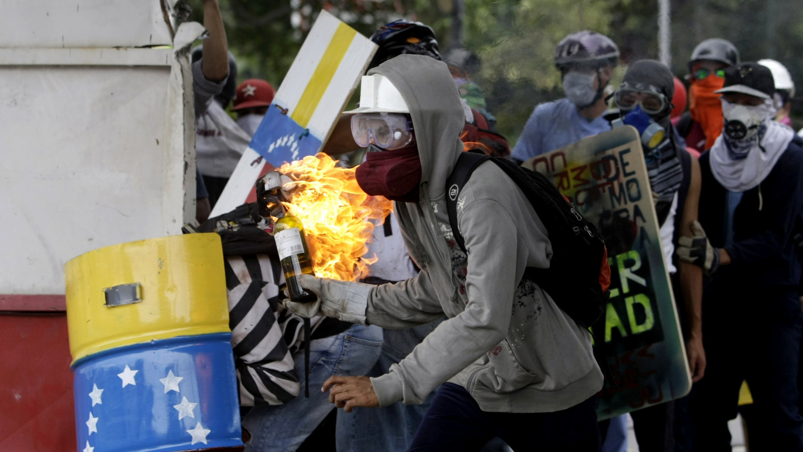 A demonstrators readies a gas bomb as he prepares to throw it at the police during clashes between police and anti-government demonstrators in Caracas, Venezuela, June 7, 2017. The clashes have claimed more than 60 lives as they enter their third month. (AP/Fernando Llano)