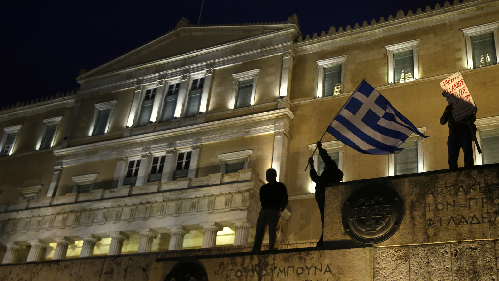 A man waves a Greek flag in front of the GreekParliament during a rally against new austeritymeasuresin Athens, May 18, 2017.(AP/Yorgos Karahalis)