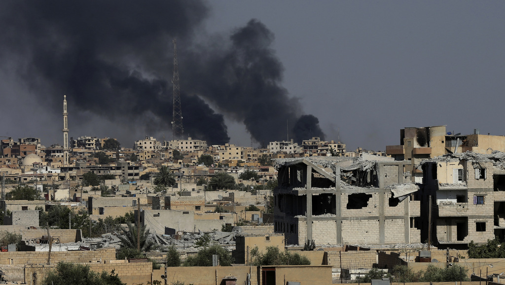 Black smoke rises from Raqqa where U.S.-forces are battling ISIS militants, in, northeast Syria, Thursday, July 27, 2017. (AP/Hussein Malla)