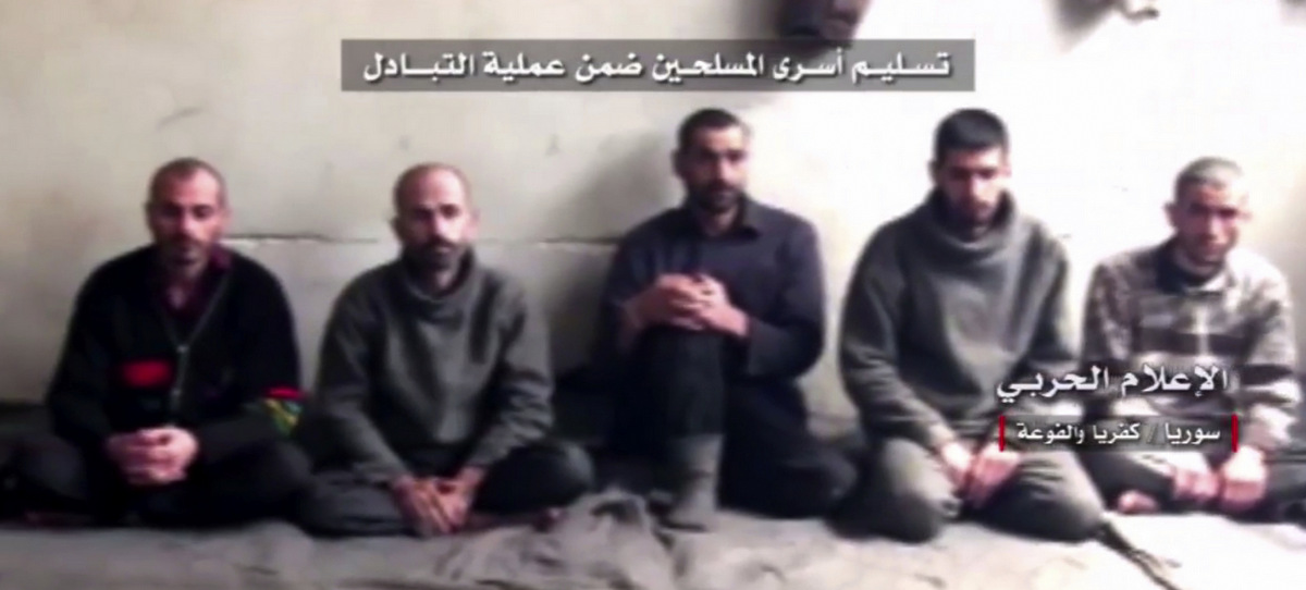 This frame grab from video provided by Syrian Central Military Media, shows Syrian rebels about to be released as part of a government deal to evacuate over 10,000 residents from Madaya and Zabadani, near Damascus, Syria, April 12, 2017.