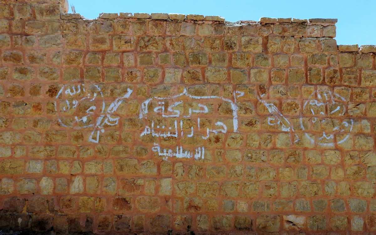 A marking of Ahrar al-Sham, the dominant Islamist rebel group occupying Madaya, in an area of modern apartments and villas.