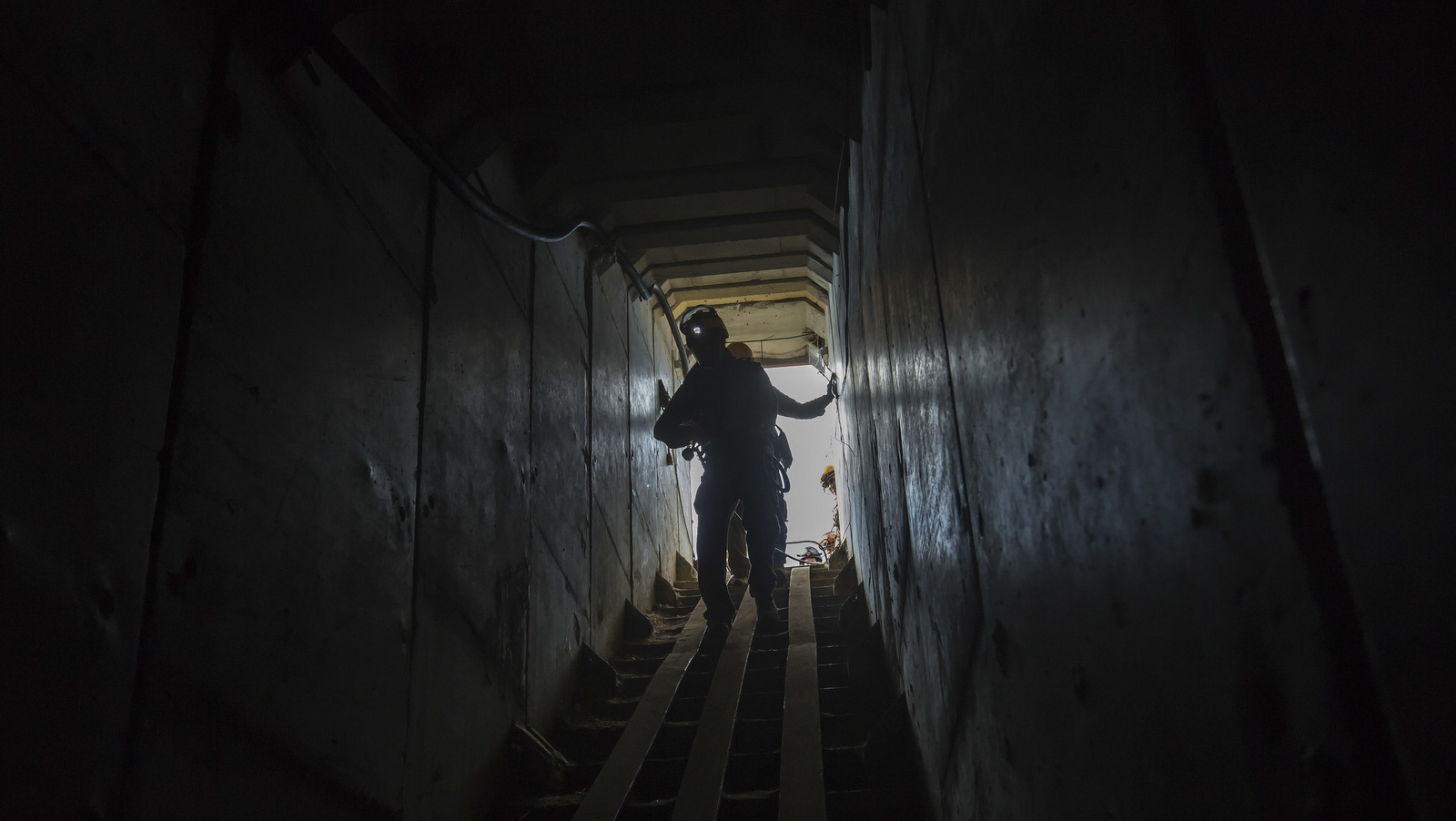 Israeli soldiers from the Home Front Command enter a tunnel, to attend to a soldier acting as a survivor in the smoke and rubble, during an army drill near the Israel Gaza border, Nov. 7, 2016. (AP/Tsafrir Abayov)