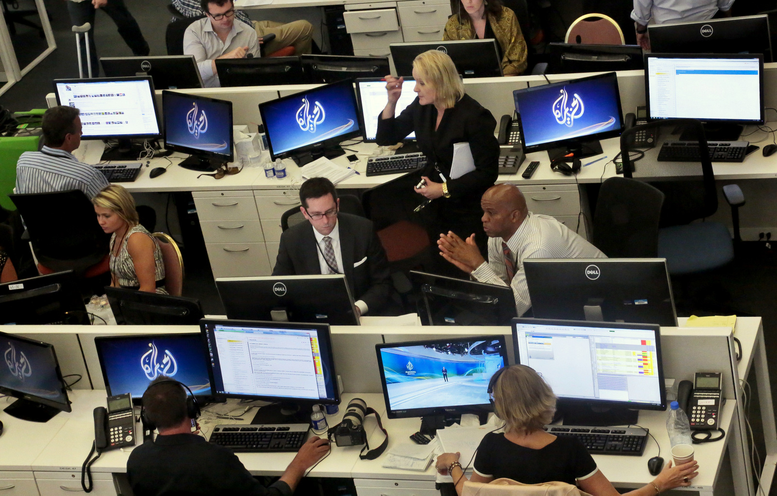 Al-Jazeera America editorial newsroom staff preparing for their first broadcast in New York. (AP/Bebeto Matthews)