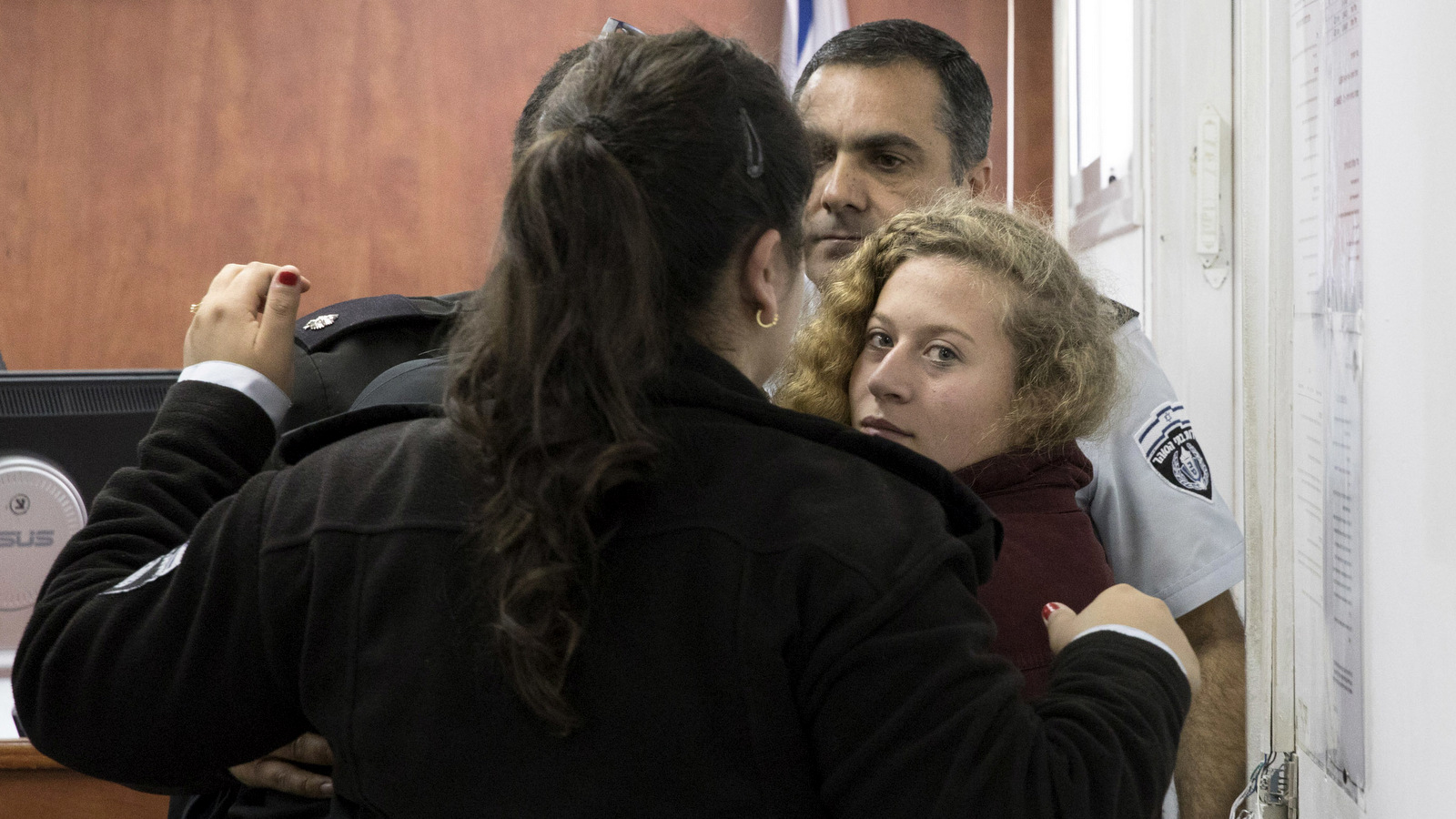 Ahed Tamimi Is escorted to a military court near occupied Jerusalem, Dec. 20, 2017. (AP/Oren Ziv)