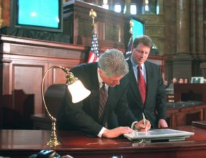 Photo: Vice President Al Gore looks on as President Clinton uses an electronic pen to sign the Telecommunications Reform Act, Thursday Feb. 8, 1996 at the Library of Congress in Washington. With high-tech fanfare and a touch of humor, the president signed the bill to revolutionize the way Americans get telephone and computer services. (AP Photo/Doug Mills)