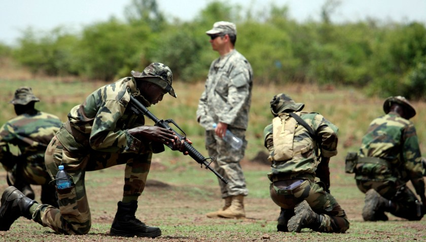 A U.S. Special Forces soldier trains troops from Senegal combat techniques in Kati, Mali, during a joint training exercise with units from several African armies. (AP/Alfred de Montesquiou)