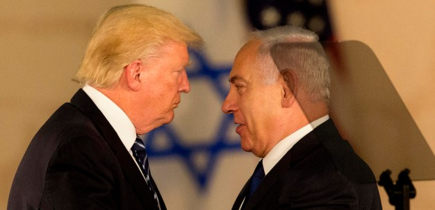 US President Donald Trump and Israeli Prime Minister Benjamin Netanyahu embrace at the Israel museum in Jerusalem, May 23, 2017. (AP/Sebastian Scheiner)