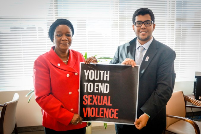 Joel Davis, chairman of Youth to End Sexual Violence, poses with Zainab Bangura, the UN's SRSG-SVC. Photo | Public Domain