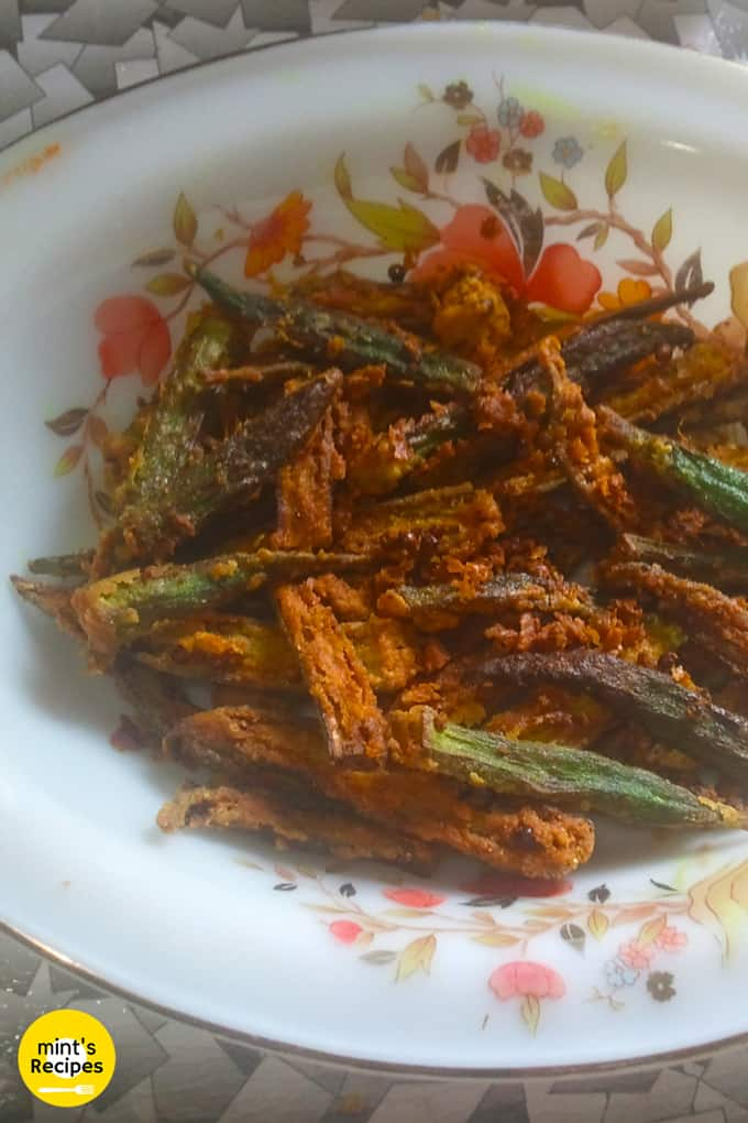 Kurkure bhindi on a floural print white plate