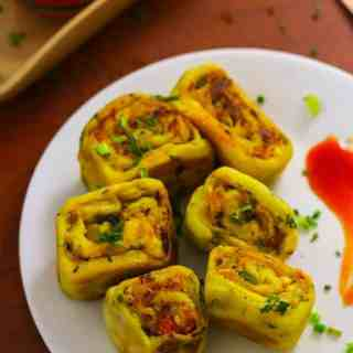 Paneer Bhurji Swiss Roll on a white plate
