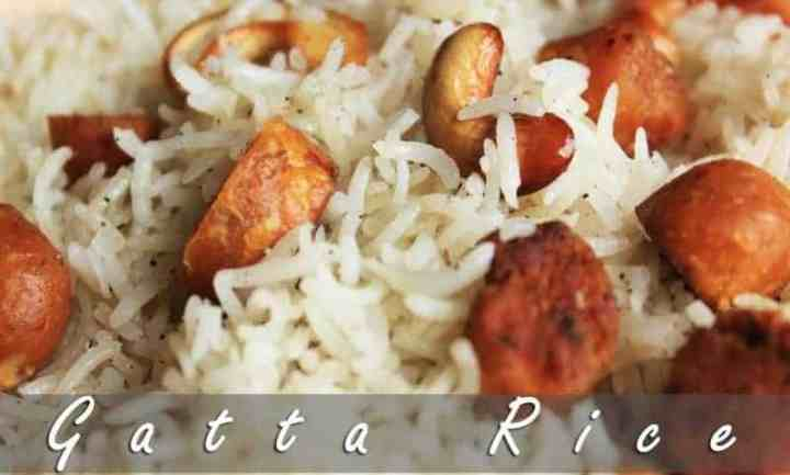 Rajasthani gatte ka pulao on a white plate garnished with fried cashew and gatte |