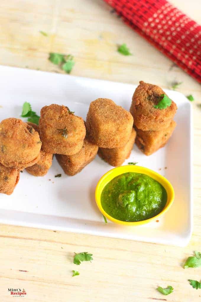 Rava Cutlet with Green chutney served on a white plate