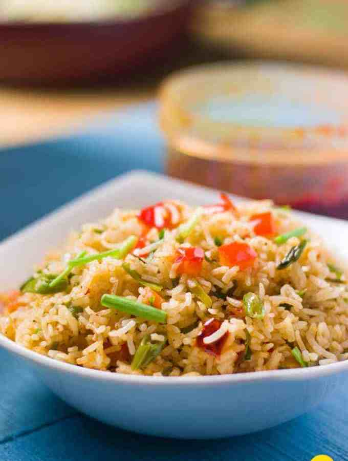 Schezwan Fried Rice Recipe served with vegetables