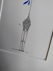 detail of a giraffe with a blue scarf.