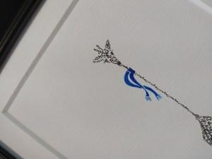 detail calligram giraffe with blue scarf